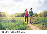 happy couple with backpacks hiking outdoors. Стоковое фото, фотограф Syda Productions / Фотобанк Лори