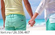Купить «Closeup hands of couple background the sea. Young couple on white beach. SLOW MOTION VIDEO.», видеоролик № 26336467, снято 12 мая 2017 г. (c) Дмитрий Травников / Фотобанк Лори