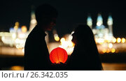 Купить «Kazan, Russia, 12 may 2017 - couple in love at festival of water Lanterns on Kazanka», видеоролик № 26342035, снято 21 июля 2018 г. (c) Константин Шишкин / Фотобанк Лори