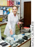 Купить «Doctor near display with orthopaedic products», фото № 26344819, снято 24 сентября 2018 г. (c) Яков Филимонов / Фотобанк Лори