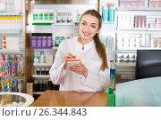 Smiling cheerful young female pharmacist posing. Стоковое фото, фотограф Яков Филимонов / Фотобанк Лори