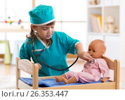 Купить «Child girl playing with doll in the hospital», фото № 26353447, снято 1 апреля 2017 г. (c) Оксана Кузьмина / Фотобанк Лори