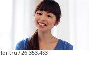 Купить «happy smiling asian young woman», видеоролик № 26353483, снято 22 марта 2017 г. (c) Syda Productions / Фотобанк Лори