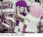 Купить «Family couple preparing for fest and choosing clown wigs», фото № 26353555, снято 11 апреля 2017 г. (c) Яков Филимонов / Фотобанк Лори