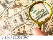 Купить «Hundred dollar bill under a magnifying glass», фото № 26358567, снято 6 мая 2017 г. (c) Валерий Бочкарев / Фотобанк Лори