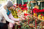 Woman with daughter looking at floral decoration at Cristmas fair, фото № 26359635, снято 25 мая 2017 г. (c) Яков Филимонов / Фотобанк Лори