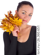 Girl holding autumn orange maple leaves on white, фото № 26360651, снято 3 октября 2012 г. (c) Tatjana Romanova / Фотобанк Лори