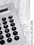 Купить «Калькулятор на газете с финансовыми новостями», фото № 26361203, снято 14 сентября 2011 г. (c) Александр Гаценко / Фотобанк Лори