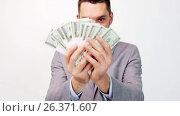 Купить «happy businessman with packets of dollar money», видеоролик № 26371607, снято 29 мая 2020 г. (c) Syda Productions / Фотобанк Лори