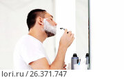 man shaving beard with safety razor at bathroom. Стоковое видео, видеограф Syda Productions / Фотобанк Лори