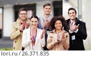 Купить «international business team name tags applauding», видеоролик № 26371835, снято 16 сентября 2019 г. (c) Syda Productions / Фотобанк Лори