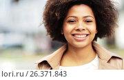 Купить «close up happy african american woman outdoors», видеоролик № 26371843, снято 8 апреля 2020 г. (c) Syda Productions / Фотобанк Лори