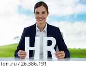Купить «Cut out HR letters with landscape», фото № 26386191, снято 13 декабря 2019 г. (c) Wavebreak Media / Фотобанк Лори