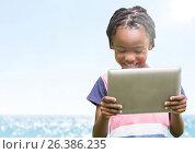 Купить «Boy with tablet against blurry water and flare», фото № 26386235, снято 8 апреля 2020 г. (c) Wavebreak Media / Фотобанк Лори