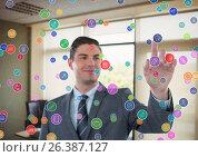 Купить «futuristic room interface color dots in the office. Businessman», фото № 26387127, снято 18 августа 2018 г. (c) Wavebreak Media / Фотобанк Лори