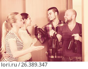 Купить «Friends gathering together at party», фото № 26389347, снято 19 февраля 2019 г. (c) Яков Филимонов / Фотобанк Лори