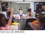 Купить «Schoolgirl taking lesson of her classmates», фото № 26394663, снято 11 марта 2017 г. (c) Wavebreak Media / Фотобанк Лори