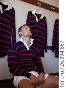 Купить «Tired rugby player looking up while sitting on bench», фото № 26394867, снято 9 февраля 2017 г. (c) Wavebreak Media / Фотобанк Лори