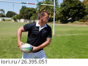 Купить «Player throwing rugby ball by goal post», фото № 26395051, снято 9 февраля 2017 г. (c) Wavebreak Media / Фотобанк Лори