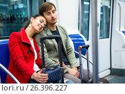 Portrait of metro passengers sitting in car seats and smiling. Стоковое фото, фотограф Яков Филимонов / Фотобанк Лори