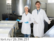 Купить «Cheerful adult man and woman on the manufacture», фото № 26396251, снято 21 июля 2018 г. (c) Яков Филимонов / Фотобанк Лори