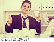 Купить «Relaxed businessman finishing work», фото № 26396287, снято 20 апреля 2017 г. (c) Яков Филимонов / Фотобанк Лори