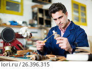Купить «Joiner working in workshop», фото № 26396315, снято 8 апреля 2017 г. (c) Яков Филимонов / Фотобанк Лори