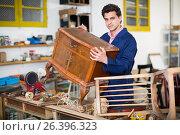 Купить «Restorer of furniture in workroom», фото № 26396323, снято 8 апреля 2017 г. (c) Яков Филимонов / Фотобанк Лори