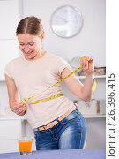 Купить «Woman controlling waistline», фото № 26396415, снято 12 апреля 2017 г. (c) Яков Филимонов / Фотобанк Лори