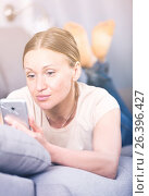 Купить «Upset woman with phone», фото № 26396427, снято 12 апреля 2017 г. (c) Яков Филимонов / Фотобанк Лори