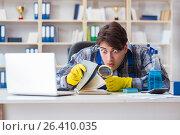 Купить «Man cleaner stealing confidential documents», фото № 26410035, снято 3 марта 2017 г. (c) Elnur / Фотобанк Лори