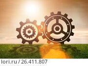 Купить «Teamwork concept with cogwheels gears», фото № 26411807, снято 18 января 2019 г. (c) Elnur / Фотобанк Лори