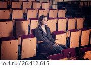 Купить «Lonely sad woman sitting in empty audience hall», фото № 26412615, снято 3 декабря 2016 г. (c) Яков Филимонов / Фотобанк Лори