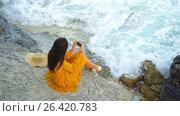 Купить «Young beautiful woman in dress at the cliff above the sea. Happy girl in the evening on the beach», видеоролик № 26420783, снято 15 мая 2017 г. (c) Дмитрий Травников / Фотобанк Лори