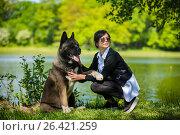Купить «Woman with an American Akita dog», фото № 26421259, снято 24 мая 2017 г. (c) Константин Тронин / Фотобанк Лори