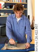 Купить «Househusband ironing», фото № 26422807, снято 27 мая 2020 г. (c) age Fotostock / Фотобанк Лори