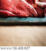 Beef red meat on paper surface, food background. Стоковое фото, фотограф Дарья Зуйкова / Фотобанк Лори