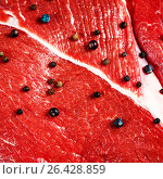 Close-up of beef red meat with black pepper. Стоковое фото, фотограф Дарья Зуйкова / Фотобанк Лори