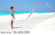 Купить «Adorable little girl playing with gymnastic ribbon on the beach. SLOW MOTION», видеоролик № 26430099, снято 29 мая 2017 г. (c) Дмитрий Травников / Фотобанк Лори
