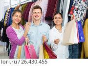 Купить «Young adults with purchases in shop», фото № 26430455, снято 8 июля 2020 г. (c) Яков Филимонов / Фотобанк Лори