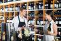 Smiling seller man giving sample taste of wine, фото № 26430555, снято 28 июля 2017 г. (c) Яков Филимонов / Фотобанк Лори