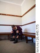 Купить «Rugby player tying sports shoes while sitting on bench», фото № 26440775, снято 9 февраля 2017 г. (c) Wavebreak Media / Фотобанк Лори