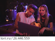 Купить «Young male and female musicians using laptop in nightclub», фото № 26446559, снято 7 марта 2017 г. (c) Wavebreak Media / Фотобанк Лори
