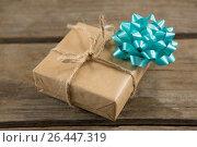 Купить «High angle view of gift box with ribbon bow», фото № 26447319, снято 21 января 2020 г. (c) Wavebreak Media / Фотобанк Лори