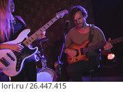 Купить «Musician playing guitar in nightclub», фото № 26447415, снято 7 марта 2017 г. (c) Wavebreak Media / Фотобанк Лори