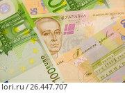 Купить «Купюры,номиналом в пятьсот гривен,лежат вместе с купюрами в сто евро», фото № 26447707, снято 14 мая 2017 г. (c) Игорь Кутателадзе / Фотобанк Лори
