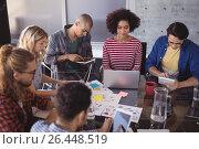 Купить «High angle view of business team working together at desk», фото № 26448519, снято 19 марта 2017 г. (c) Wavebreak Media / Фотобанк Лори
