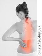 Rear view of female suffering from back pain. Стоковое фото, агентство Wavebreak Media / Фотобанк Лори