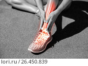 Купить «Low section of female athlete suffering from pain on track», фото № 26450839, снято 21 августа 2018 г. (c) Wavebreak Media / Фотобанк Лори