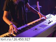 Купить «Mid section of male musician playing piano», фото № 26450927, снято 7 марта 2017 г. (c) Wavebreak Media / Фотобанк Лори
